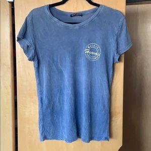 A blue short sleeved shirt from Brandy Melville